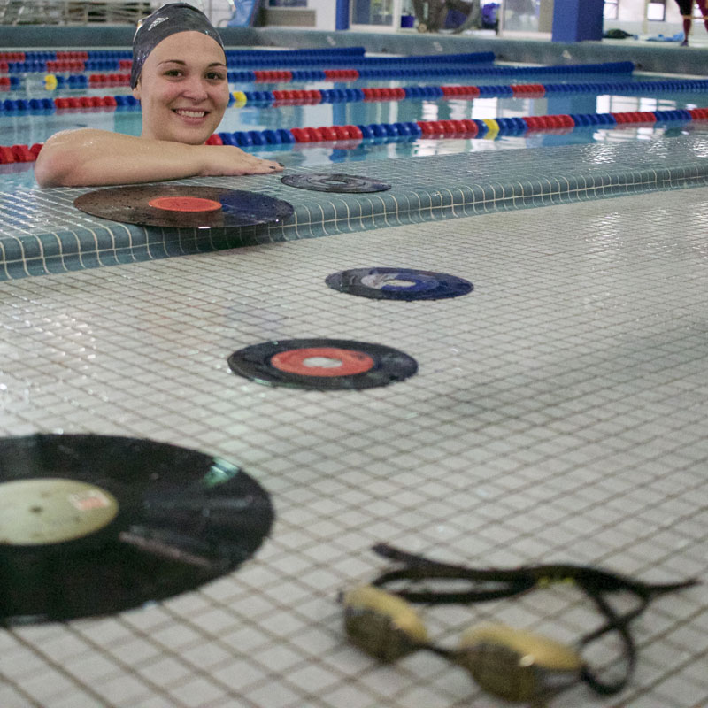 Walker poses with records by the pool